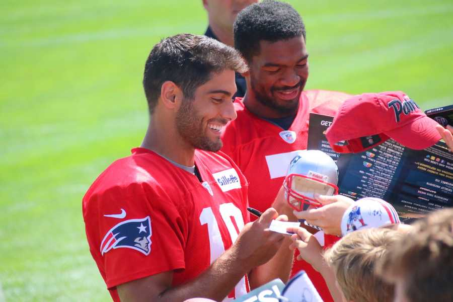 Jimmy Garoppolo and Jacoby Bresette smile as they sign fan autographs after practice Wednesday. This was the final open practice for Patriots fans to attend.