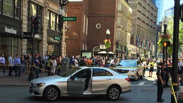 A car struck at least two pedestrians in Boston.