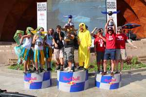 Team FliteRiot, (first), team What Sphinx?, (second), and team Something Wonderful, (third), celebrate during the podium ceremony at Red Bull Flugtag in Boston.