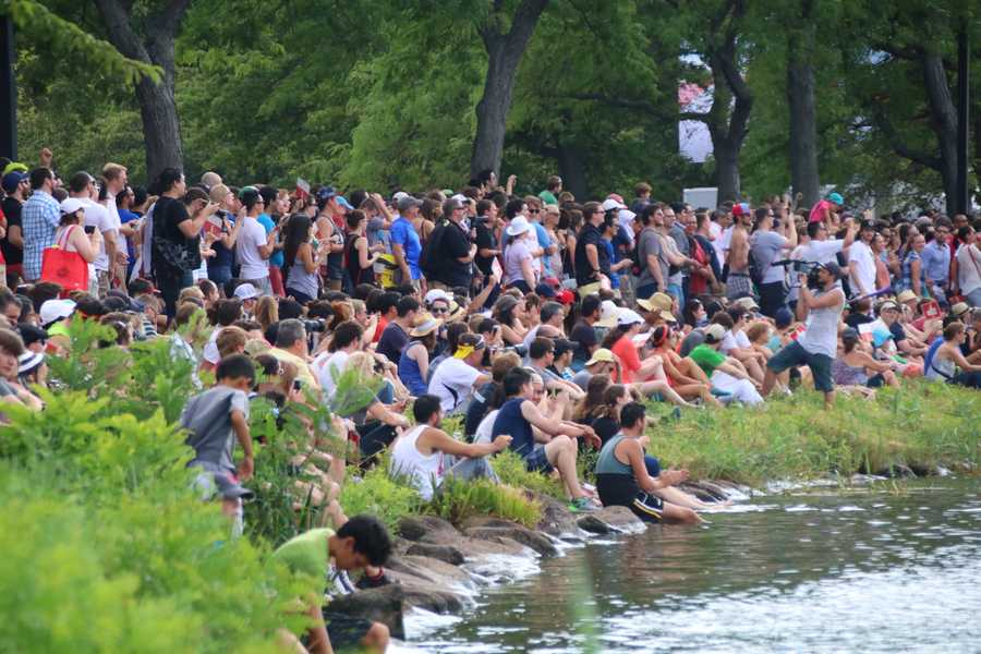 An estimated 20,000 people packed the shores of the Charles River to watch the event.