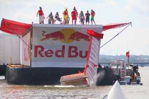 The plane portion of the Team Flying Franks aircraft crashes into the river at the Red Bull Flugtag in Boston.