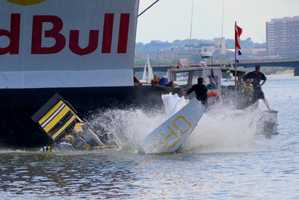 Team Flight Orr Fight crashes into the Charles River at the Red Bull Flugtag in B