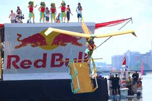 Team What Sphinx launches off the platform at the Red Bull Flugtag in Boston.