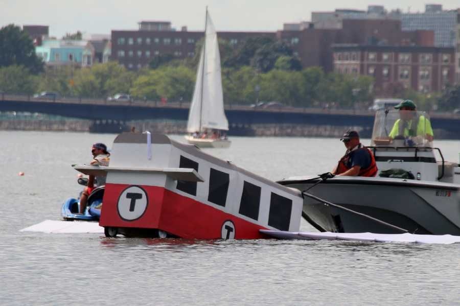 The remnants of Team Breakdown Charlie -- a Red Line MBTA float -- is towed down the Charles River at Red Bull Flutag in Boston.