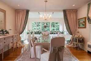 Chef's kitchen, formal living & dining rooms, library and family room with fireplace on first level.