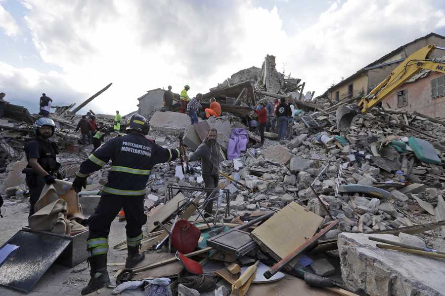 Rescuers search for survivors through the rubble of collapsed buildings following an earthquake, in Amatrice, Italy, Wednesday, Aug. 24, 2016. The magnitude 6 quake struck at 3:36 a.m. and was felt across a broad swath of central Italy, including Rome where residents of the capital felt a long swaying followed by aftershocks.