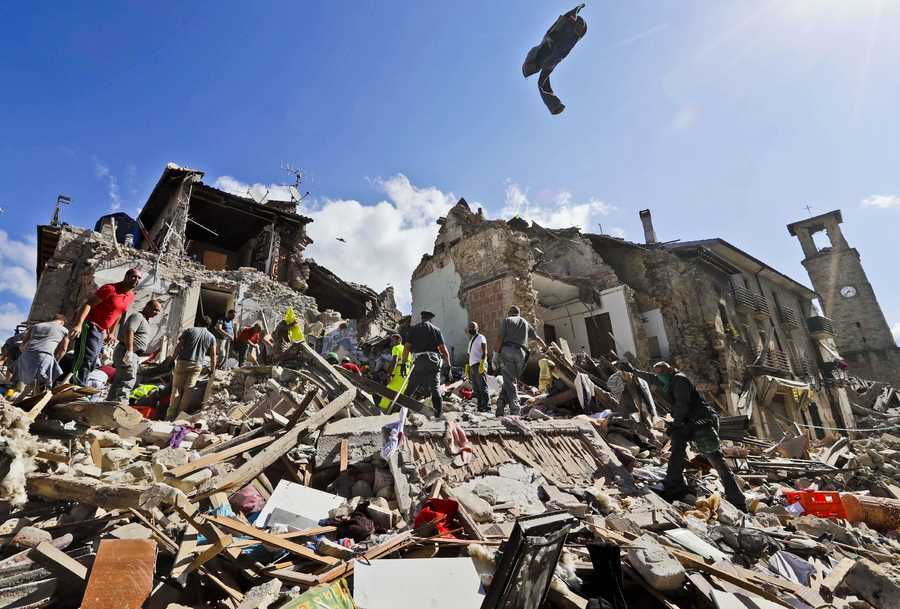Rescuers search amid rubble following an earthquake in Amatrice Italy, Wednesday, Aug. 24, 2016. The magnitude 6 quake struck at 3:36 a.m. and was felt across a broad swath of central Italy, including Rome where residents of the capital felt a long swaying followed by aftershocks.