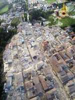 This aerial view shows the damage in the town of Amatrice, central Italy, Wednesday, Aug. 24, 2016 following an earthquake. A strong earthquake rocked central Italy early Wednesday, collapsing homes on top of residents as they slept.
