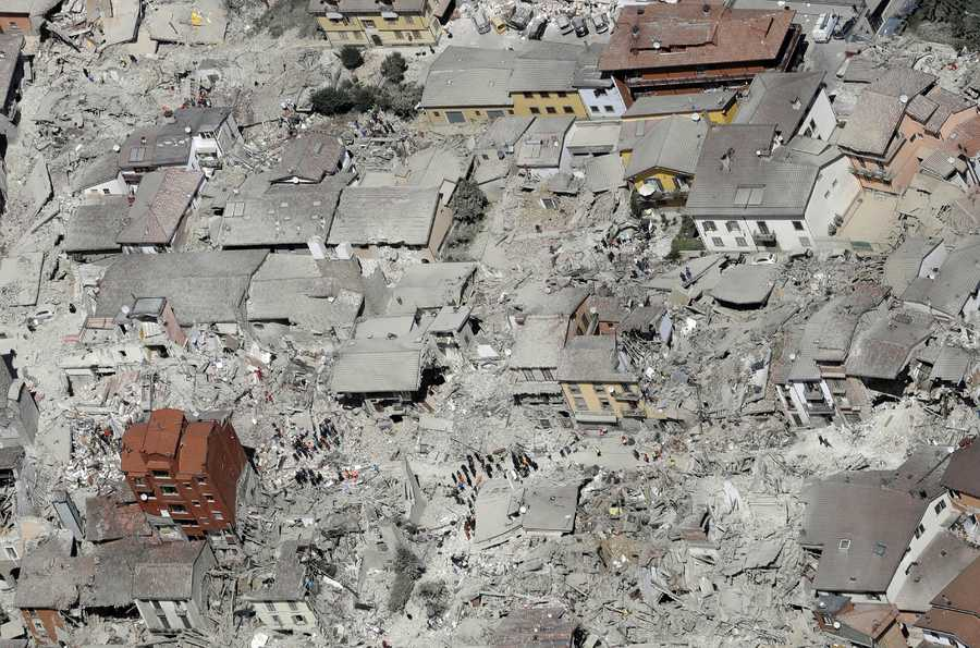 This aerial photo shows the damaged buildings in the town of Amatrice, central Italy, after an earthquake, Wednesday, Aug. 24, 2016. The magnitude 6 quake struck at 3:36 a.m. and was felt across a broad swath of central Italy, including Rome where residents of the capital felt a long swaying followed by aftershocks.