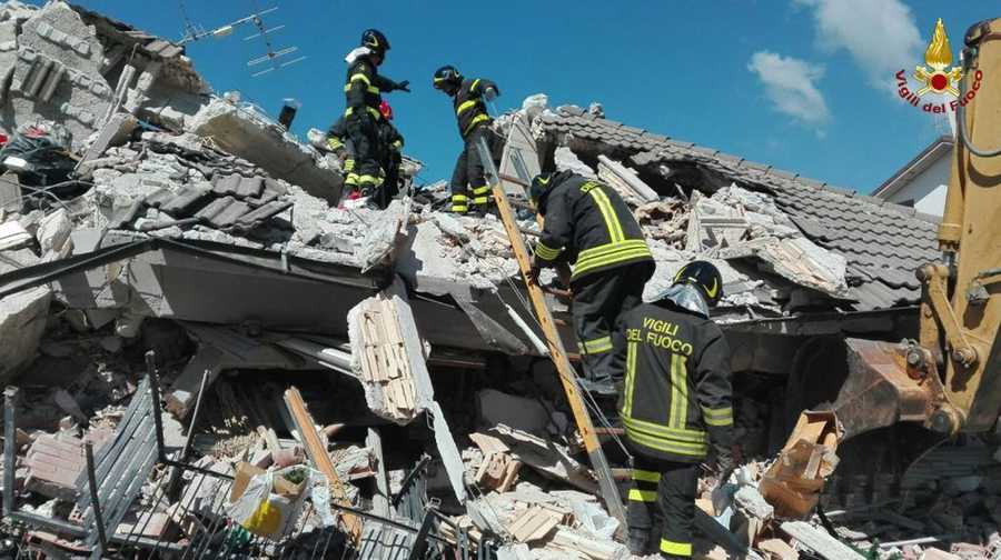 Firefighters search through debris of a collapsed building following an earthquake in Amatrice, central Italy, Wednesday, Aug. 24, 2016. A strong earthquake in central Italy reduced three towns to rubble as people slept early Wednesday, with reports that as many as 50 people were killed and hundreds injured as rescue crews raced to dig out survivors.