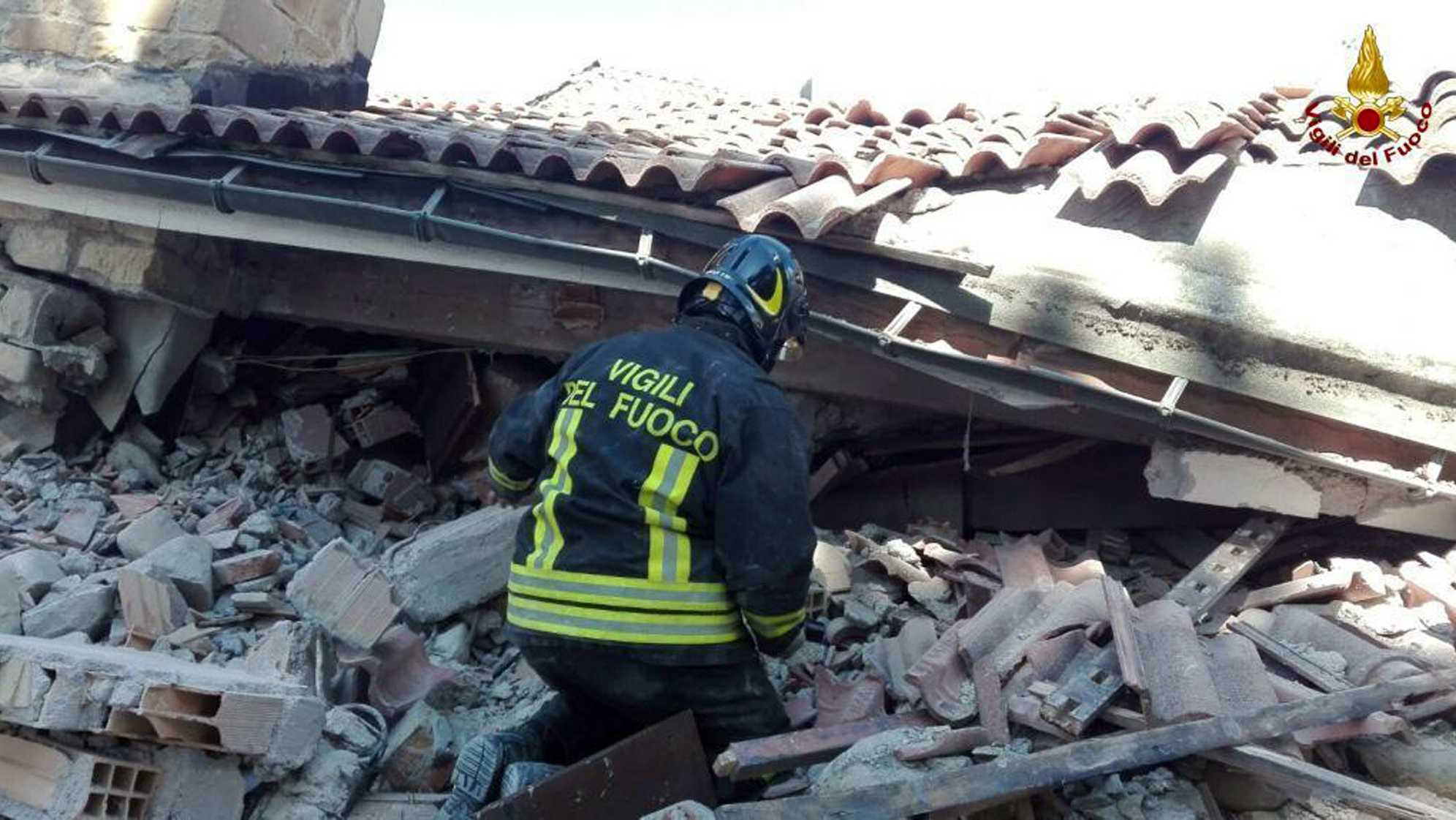 A firefighter searches through debris of a collapsed building following an earthquake in Amatrice, central Italy, Wednesday, Aug. 24, 2016. A strong earthquake in central Italy reduced three towns to rubble as people slept early Wednesday, with reports that as many as 50 people were killed and hundreds injured as rescue crews raced to dig out survivors.