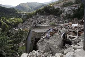 A view of collapsed houses following an earthquake in Pescara Del Tronto, Wednesday, Aug. 24, 2016. The magnitude 6 quake struck at 3:36 a.m. (0136 GMT) and was felt across a broad swath of central Italy, including Rome where residents of the capital felt a long swaying followed by aftershocks.