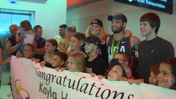 Olympians Kayla Harrison, who calls Marblehead home, and Travis Stevens, of Washington state, pose with young fans with their Judo medals.