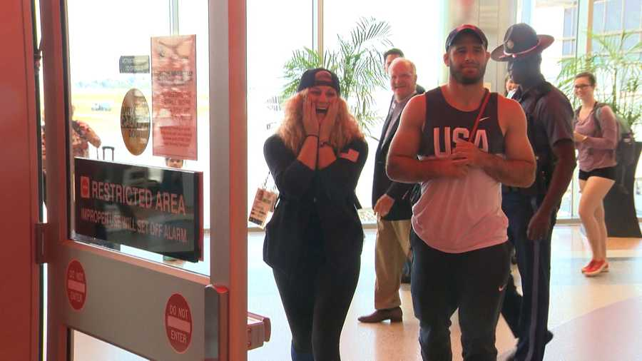 Kayla Harrison and Travis Stevens react to the surprise homecoming.