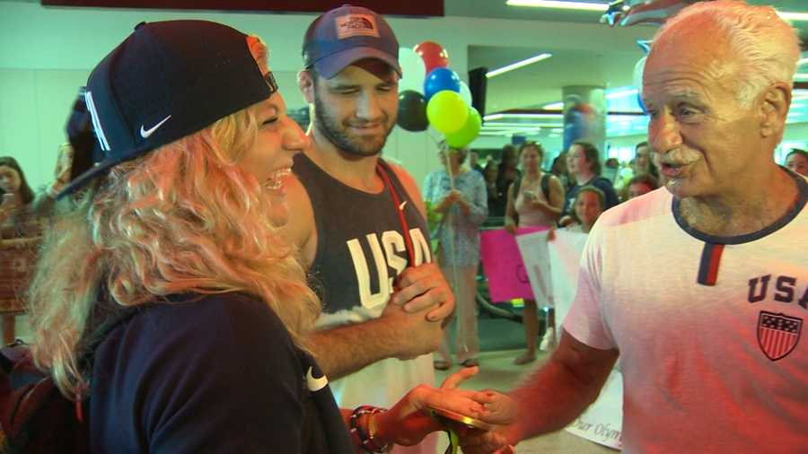 It was a gold medal homecoming for some local Olympians Wednesday at Logan Airport.