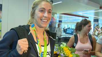 Olympic rower Gevvie Stone brings a Silver medal back to her hometown o f Newton from Rio.