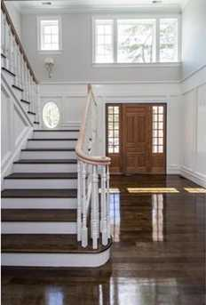 Dramatic two story foyer w/curved staircase opens to an intelligently designed floorplan perfect for today's lifestyle.