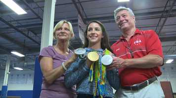 Raisman with the owners of  Brestyan's American Gymnastic Club.