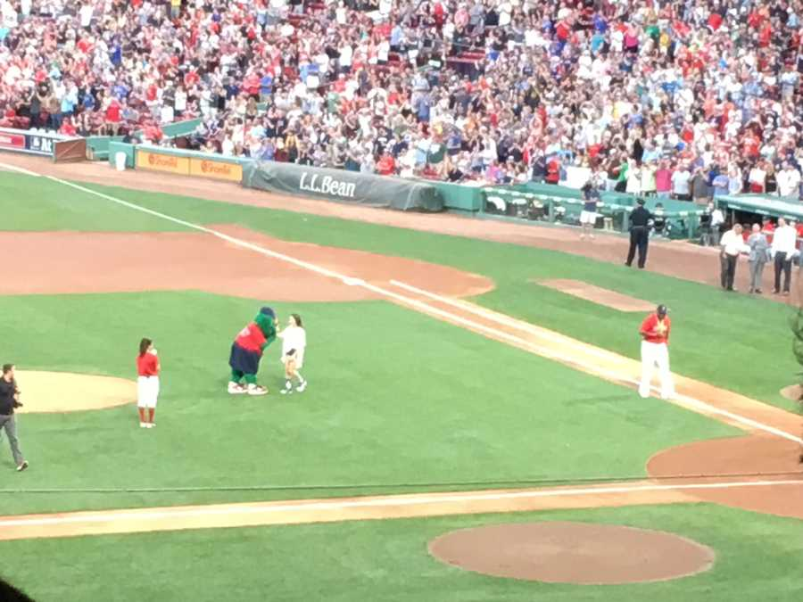 Gold medalist and Needham-native Aly Raisman throws out the first pitch at the Boston Red Sox game at Fenway Friday night.