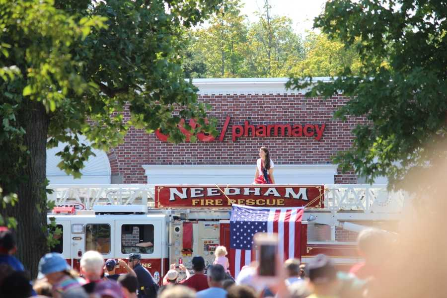 Raisman arrives to her rally on a Needham Fire rescue truck.