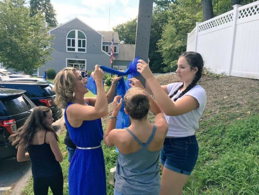 In a show of support, wives of state troopers are tying blue ribbons across Massachusetts.