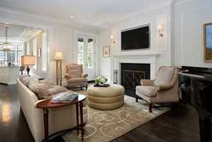 A gracious parlor level has a welcoming double entry into the main living level.