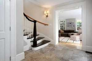 An architecturally significant oval staircase ascends from the foyer to the 4th floor of the home.