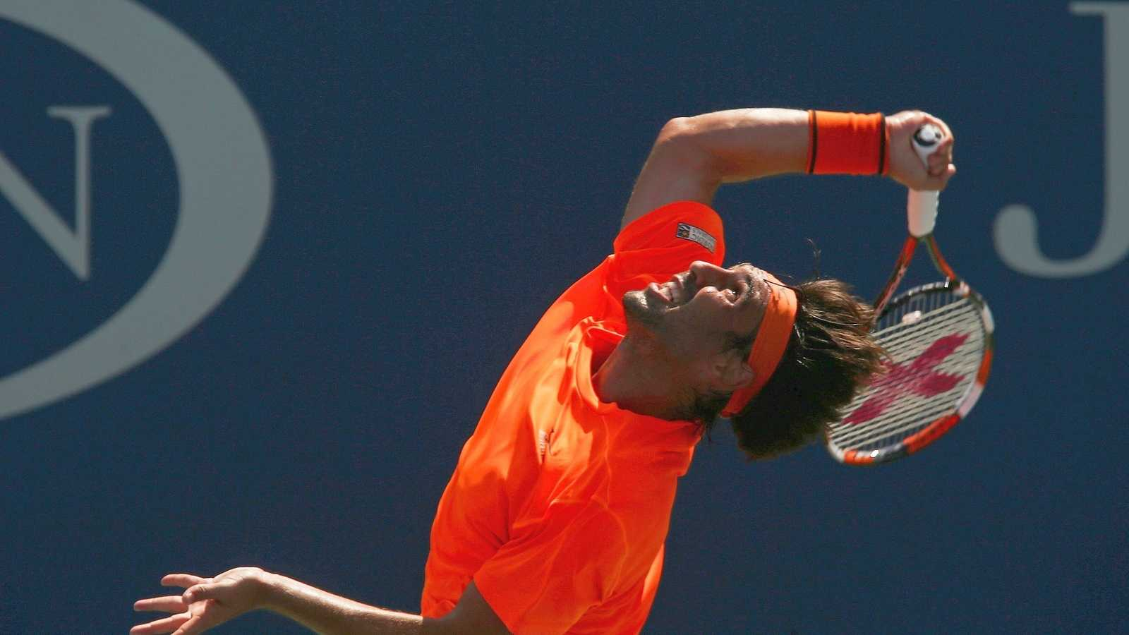 Marcos Baghdatis, of Cyprus, serves to Gael Monfils, of France, during the fourth round of the U.S. Open tennis tournament, Sunday, Sept. 4, 2016, in New York.