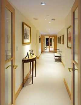 Gallery hallway has two sets of custom-designed maple french doors for privacy.