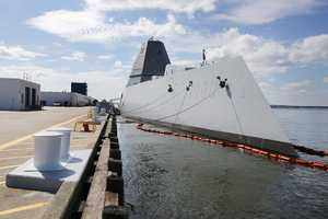 The USS Zumwalt sits at dock at the naval station in Newport, R.I., Friday, Sept. 9, 2016. The 610-foot-long warship has an angular shape to minimize its radar signature and cost more than $4.4 billion. It's the most expensive destroyer built for the Navy.