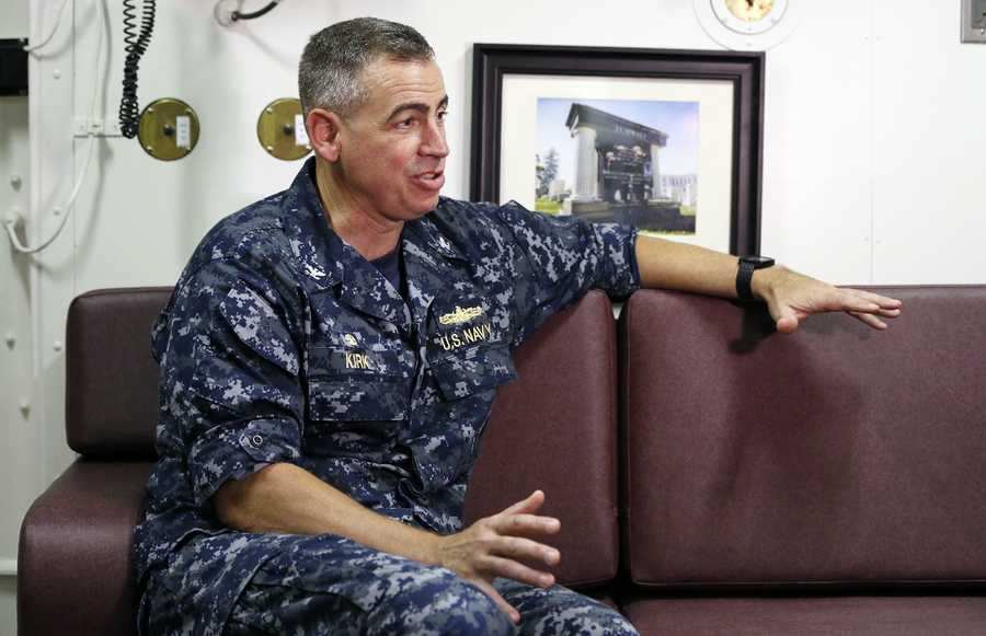 Capt. James Kirk talks with a reporter aboard the USS Zumwalt while at dock at the naval station in Newport, R.I., Friday, Sept. 9, 2016.