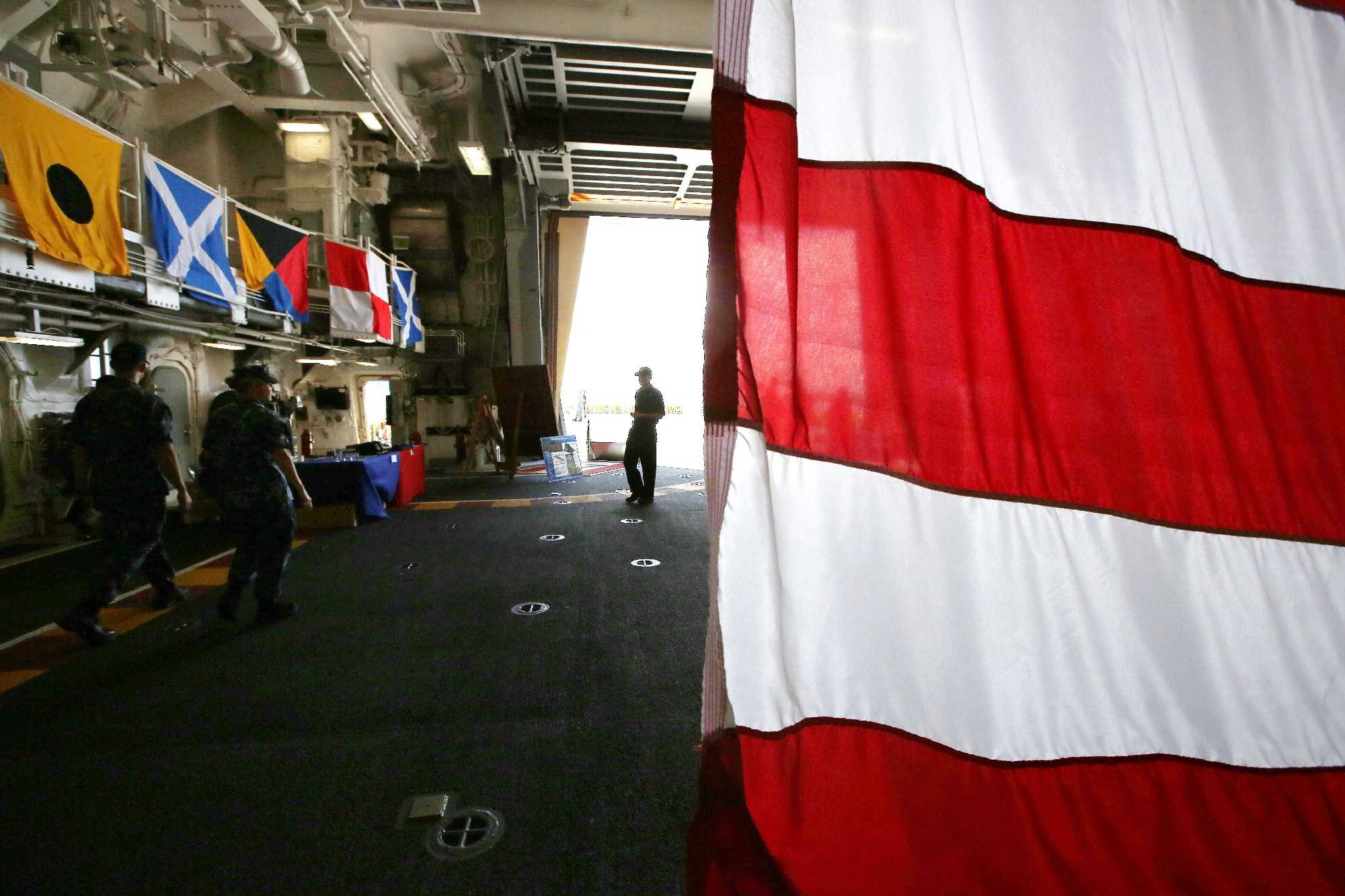 A sailor is silhouetted in the hangar door aboard the USS Zumwalt while at dock at & USS Zumwalt: Go aboard the Navy\u0027s stealthy new destroyer
