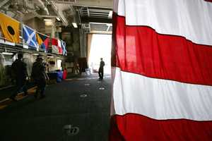 A sailor is silhouetted in the hangar door aboard the USS Zumwalt while at dock at the naval station in Newport, R.I., Friday, Sept. 9, 2016.
