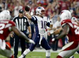 New England Patriots quarterback Jimmy Garoppolo (10) throws against the Arizona Cardinals during an NFL football game, Sunday, Sept. 11, 2016, in Glendale, Ariz.