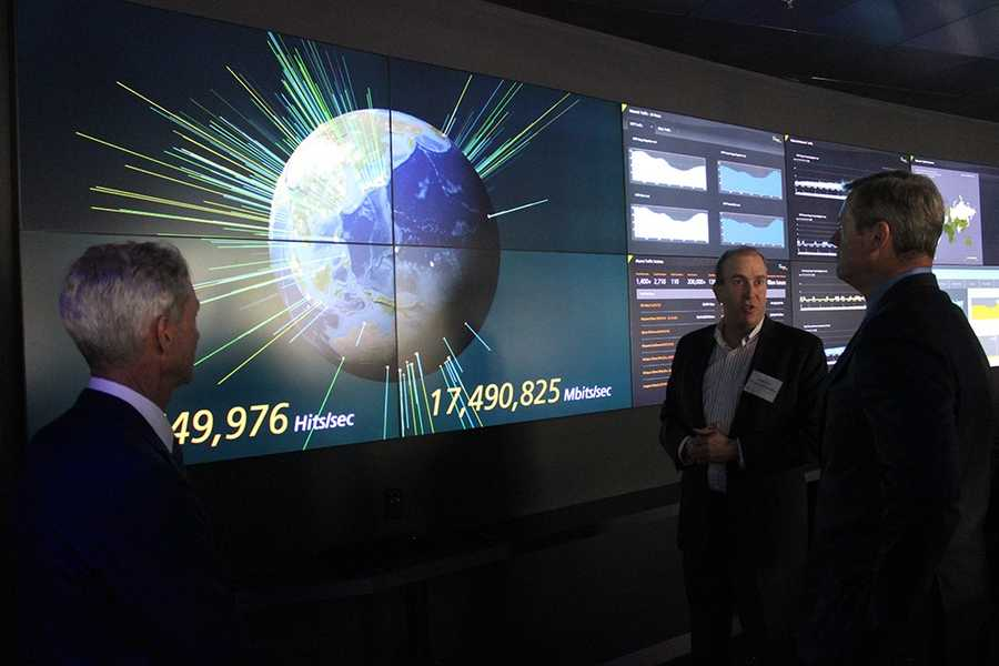 Akamai's business is to make the internet faster and more efficient by keeping popular content nearby and serving it up quickly to users. Here, Gov. Charlie Baker is shown a visualization of the work being done by the Massachusetts company's servers around the globe.