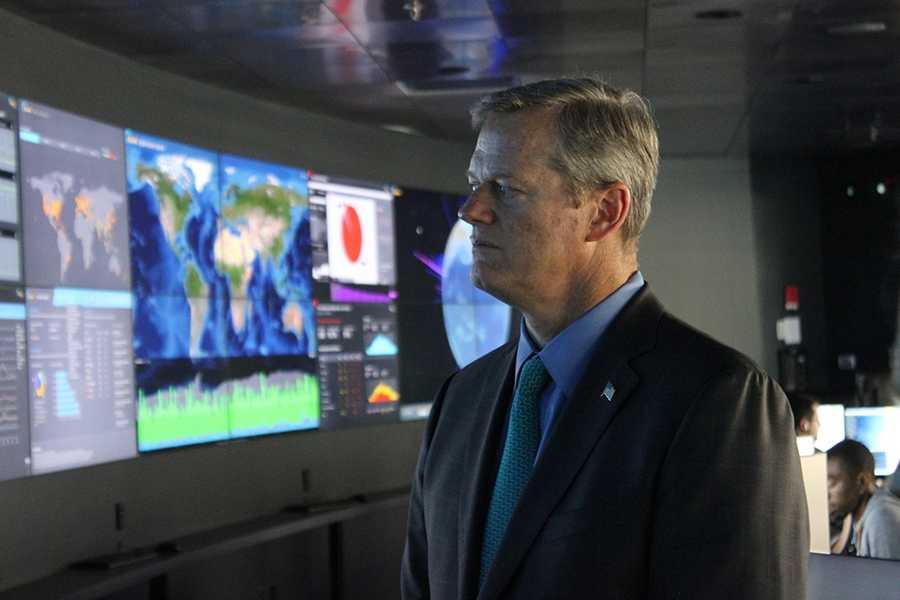 Gov. Baker listens during a tour of Akamai's Cambridge headquarters.