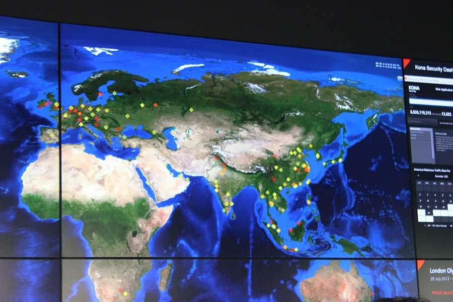 Akamai's business is delivering digital content rapidly and also filtering out digital threats, which are tracked on one of the large maps in the operation center.