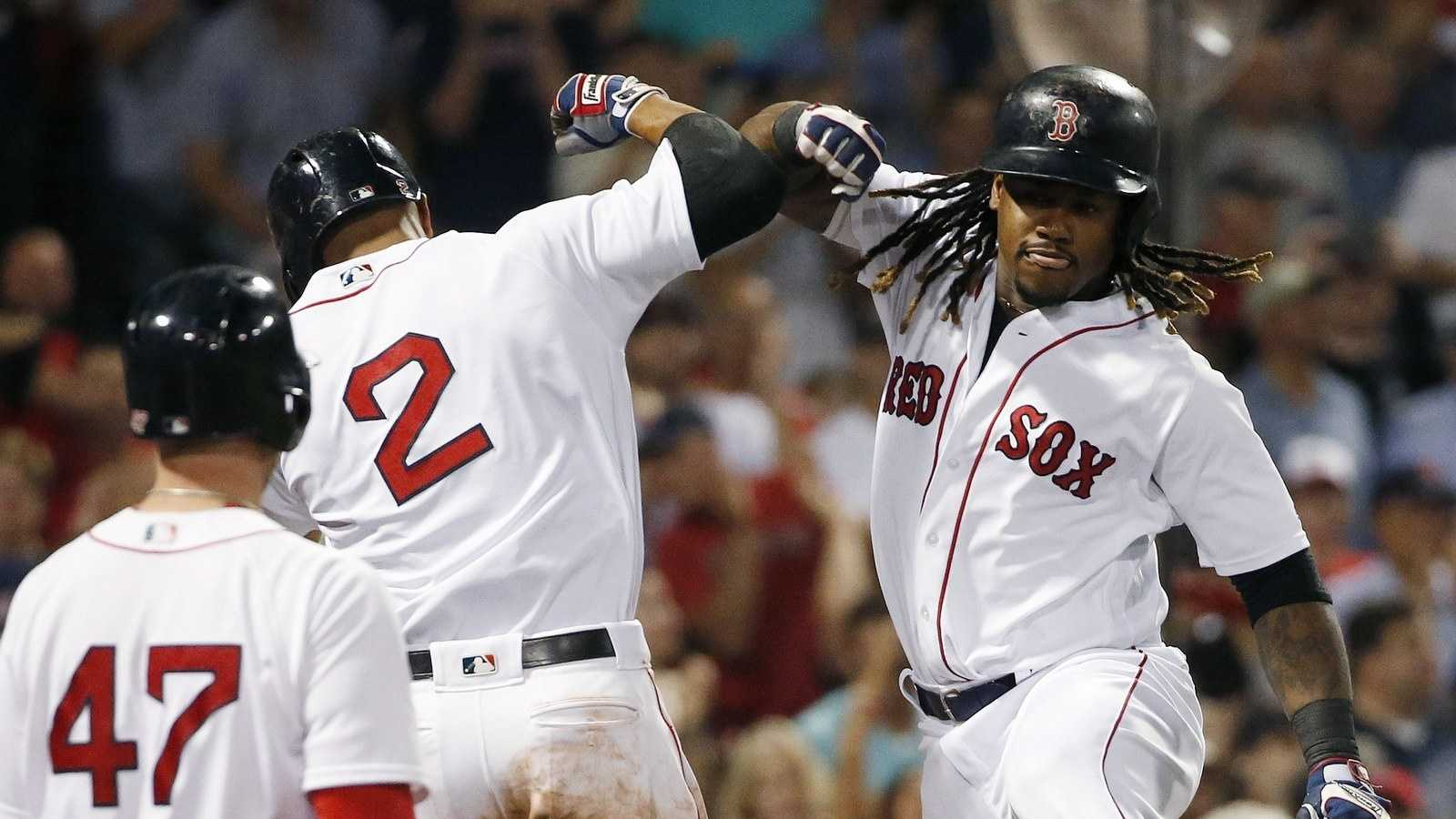 Boston Red Sox's Hanley Ramirez, right, celebrates his three-run home run that also drove in Xander Bogaerts (2) during the fifth inning of a baseball game against the New York Yankees in Boston, Sunday, Sept. 18, 2016.