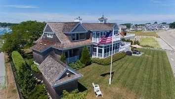 Exquisite Nantucket Shingle style home in coveted First Cliff.