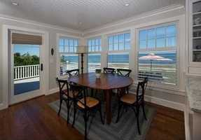 Open floor plan with soaring ceilings, walls of glass, balcony decks and screened porch.