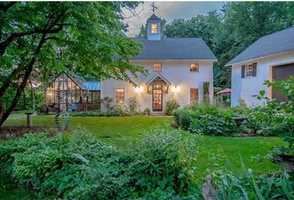The elegantly restored Calmore Estate, on 2+ beautifully landscaped, stonewalled acres overlooking Dunstable center, with an expanded 1812 federal colonial is graced by classic verandas.
