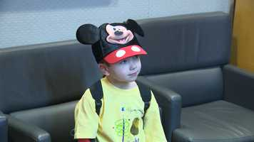 Giovanni's got his Mickey ears and is ready to go!
