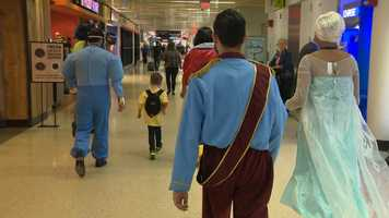 American Airlines employees dressed as Disney characters escorted Giovanni and his family to the gate from his limo.