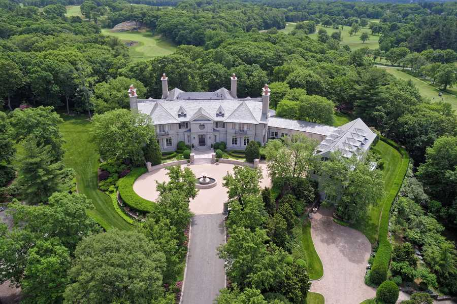 Woodland Manor at 150 Woodland Road, which is surrounded by the Brookline Country Club and Putterham Meadows Golf Course, is owned by Paul and Phyllis Fireman.