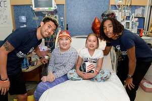 """New England Revolution players Brad Knighton, Zachary Herivaux, Daigo Kobayashi and Lee Nguyen visited patients at Boston Children's Hospital as part of the team's efforts to """"Kick Childhood Cancer"""" during Childhood Cancer Awareness Month."""