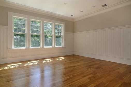 Serene and dramatic open floor plan with classic architecture and appointment.