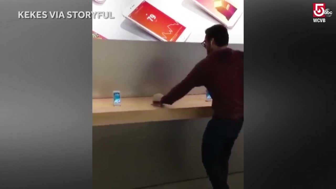 A man apparently upset about customer service he had received used a metal ball to smash several iPhones and a laptop at an Apple store in Dijon, France.