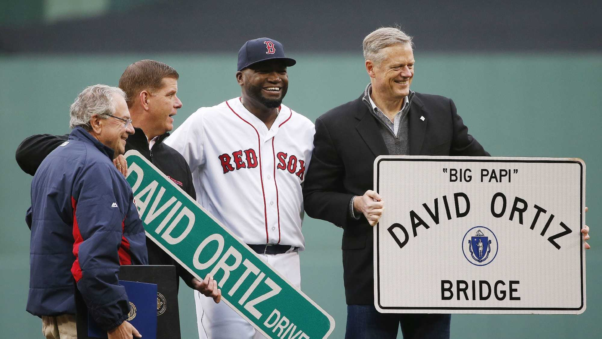 Boston Red Sox's David Ortiz, center, stands with Massachusetts Gov. Charlie Baker, right, Boston Mayor Marty Walsh, second from left, and Massachusetts Speaker of House Robert DeLeo during a ceremony to honor Ortiz before a baseball game against the Toronto Blue Jays in Boston, Sunday, Oct. 2, 2016.