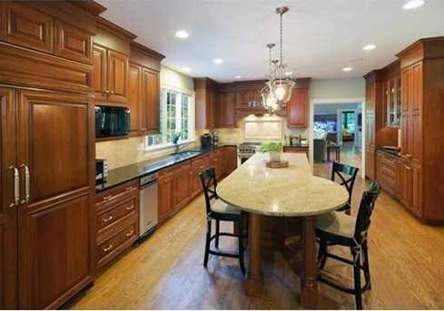 There is a cook's kitchen with granite counters & an adjoining breakfast room.