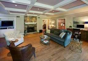 The spacious basement has a wine cellar, an exercise room, a great room, plus plenty of storage